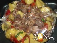 Приготовление свинины с овощами, запеченной в рукаве: шаг 7