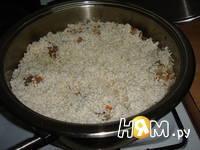 Приготовление плова из курицы с изюмом: шаг 6